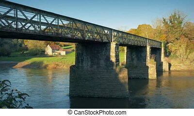 Old Railway Bridge Over River At Sunset