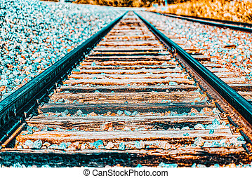 Old railway sleepers and rails in an American town. USA.