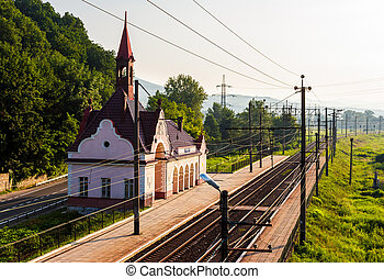old railway station at sunrise. beautiful scenery in...