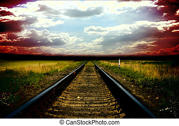 Old railway tostorm sky with clouds