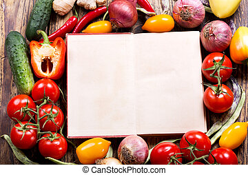 Old recipe book with vegetables for cooking
