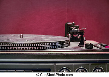 Old record player on red background