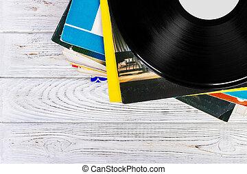 old records stack. vintage on wooden background