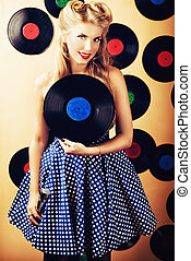 old records - Charming pin-up woman with retro hairstyle and...