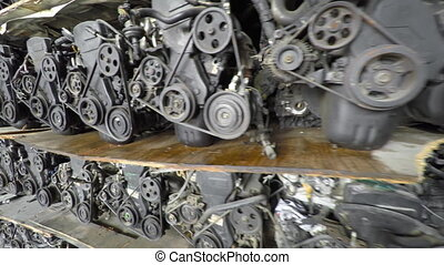 Old, Recycled Car Engines Stacked for Sale in a Warehouse -...