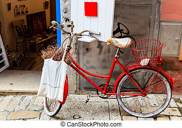 Old Red Bicycle at the Shop Door in Rovinj, Croatia