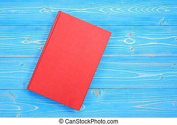 Old red book on wooden plank background. Blank empty cover ...