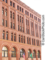 Old Red Brick Building with Arched Windows