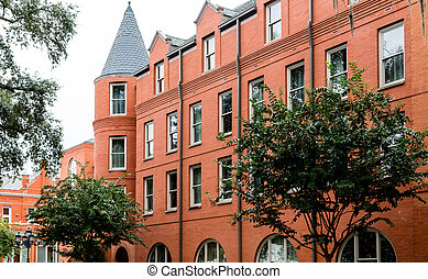 Old Red Brick Building with Turret Windows