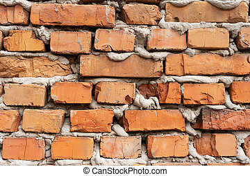 old red brick falling apart wall texture background.