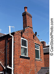 Old red brick house with chimney