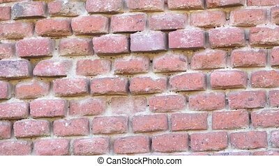 Old red brick wall. Destroyed brick wall.