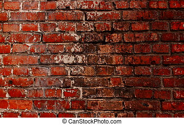 Old red brick wall with a crack and traces of paint - A...