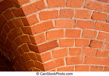 Old red brick wall with an arc background