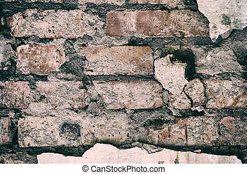 Old red brick wall with plaster