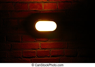 Old red brick wall with street light