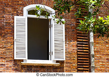 Old red brick wall with window