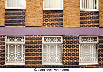 Old red brick wall with windows in Wolverhampton