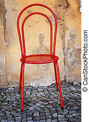 Old red Chair, on wall background