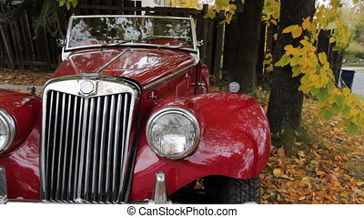 Old red convertible. - An old red convertible MG car. Note...