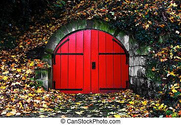 red door - old red door covered in autumn leaves