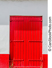 Old red Door on White Wall