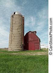 old red farm barn with concrete silo