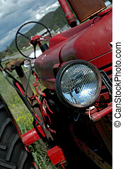 Old Red Farm Tractor - Close-Up of an old red farm tractor.