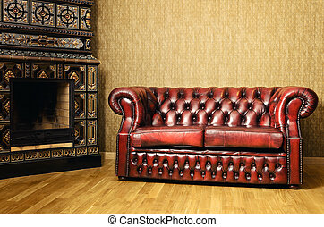 Sofa Near The Fireplace - Old Red Genuine Leather Sofa Near...