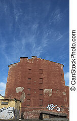 old red house over blue sky