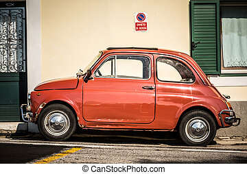 Old, red Italian car - Old, red, tiny, cute Fiat 500 .
