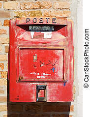 Old red mail box - Old red Italian mail box on a wall.