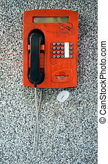 Old red telephone booth on the grey background
