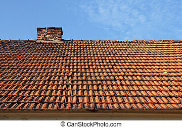 old red tile roof with chimney