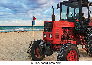 tractor on the sandy beach