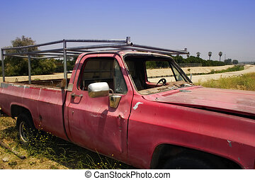 Old Red Truck - An old beat up red pickup truck.