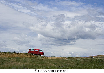 Old red van on a cloudy day