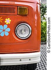 Old red vintage van decorated with flowers