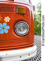 Old red vintage van decorated with flowers