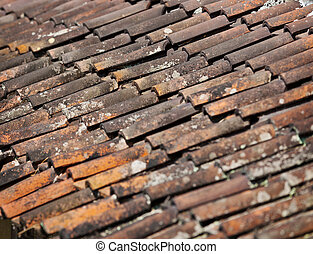 Old red weathered clay tiled roof surface