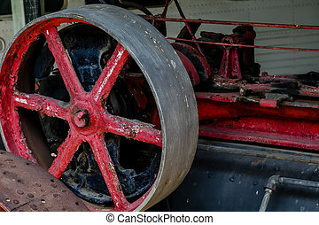 Old Red Wheel in Machinery