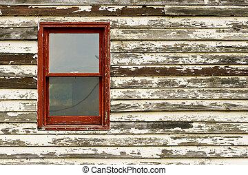 Old Red Window in Paint Peeling Building
