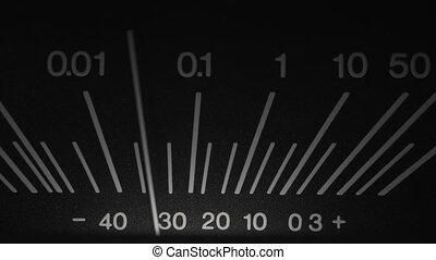 Old Reel Tape recorder close up. Shallow DOF of standard volume indicator scale. Vintage audio device analog VU meter. Recording studio