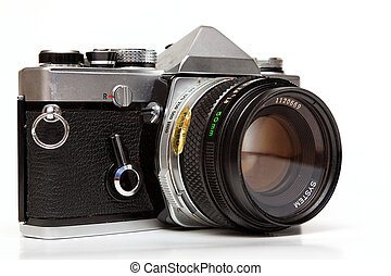Old reflex camera. - Old reflex camera on a white...