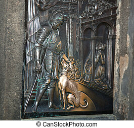 old relief below the statue of St. John of Nepomuk on Charles Bridge in Prague.