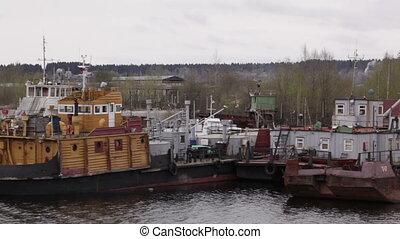 Old repair and freight ships at berth