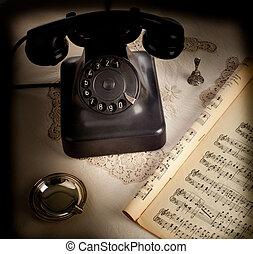 Old retro bakelite telephone on white background