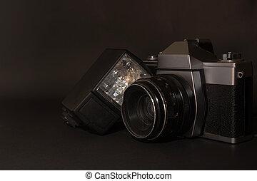 Old retro camera on black backgroun