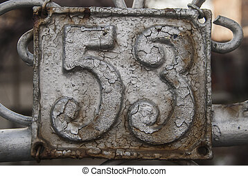 Old retro cast iron plate number 53