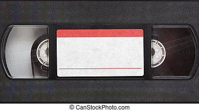 Old retro magnetic videotape with blank label. Top view